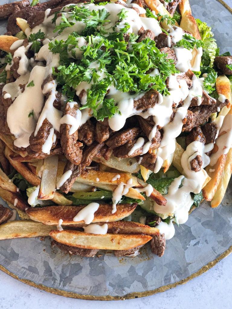 Stacked Beef Shawarma Salad, shawarma fries, beef shawarma salad bowl