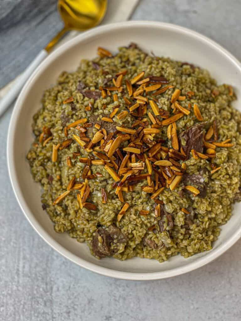 Lebanese style Freekeh with Beef topped with roasted nuts
