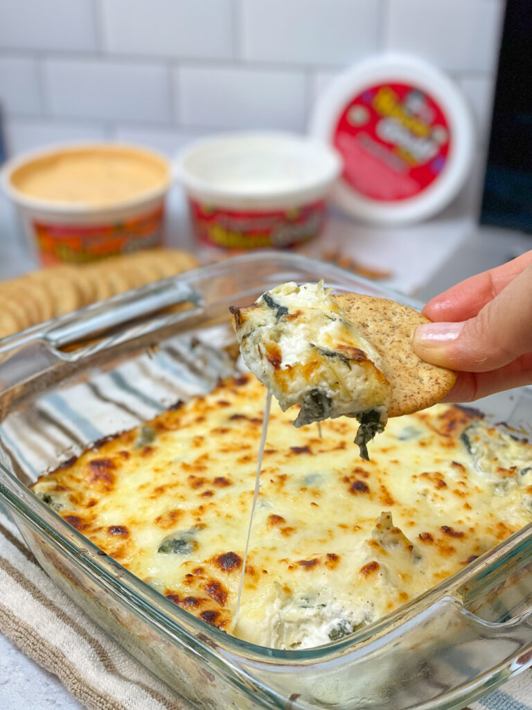 Warm appetizer spinach artichoke dip served best with chips or crackers easy tasty