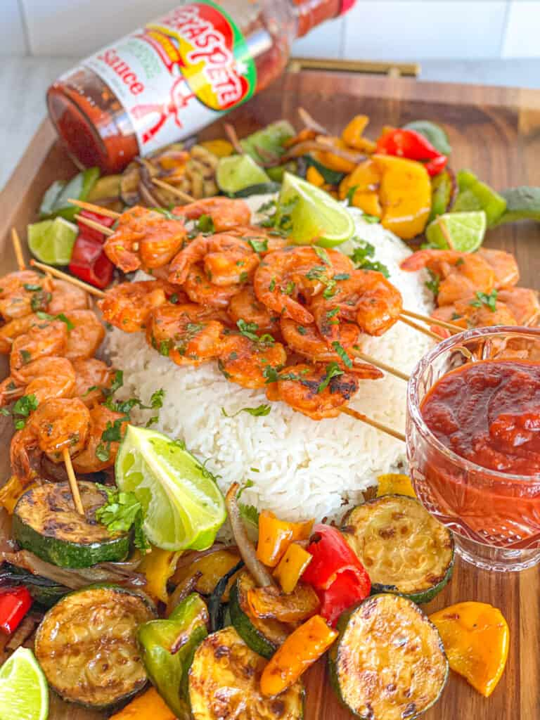 An easy and quick grilled shrimp recipe that takes on a life of its own! This Grilled Lime Cilantro Shrimp is marinated in a tangy refreshing mix great for summer food fun