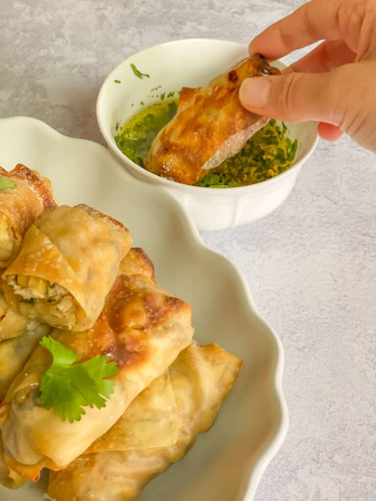 Golden Air-Fried, Deep-Fried, or Baked Chicken Eggrolls with Almond Cilantro dipping sauce or a lime ranch dip or buffalo sauce