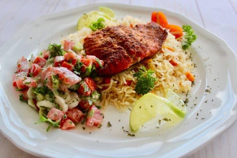 cajun salmon over cajun rice served with tahini salad