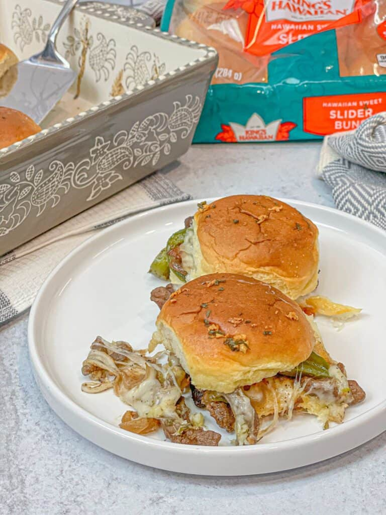 Philly Cheesesteak Sliders with provolone cheese, peppers, onions, and delicious spices with a butter covered bun that is easy to make.