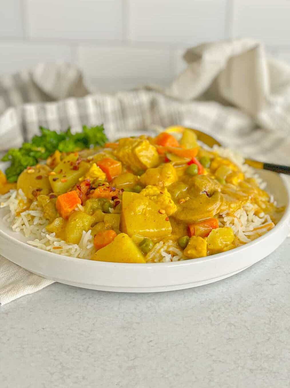Creamy and easy chicken vegetable curry on a bed of white rice