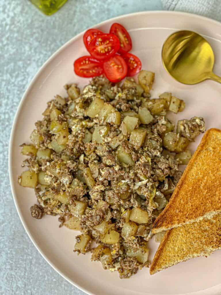potato scramble made with meat, potatoes, onion and egg