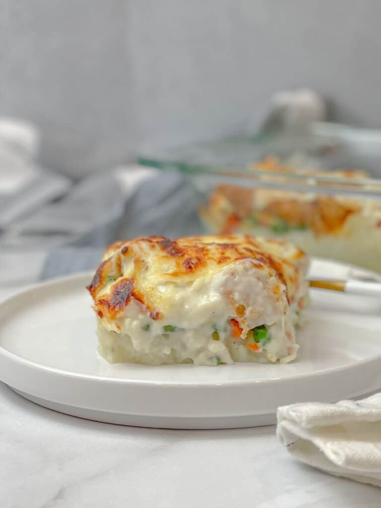 A creamy, delicious, and cheesy potato and chicken bake with veggies