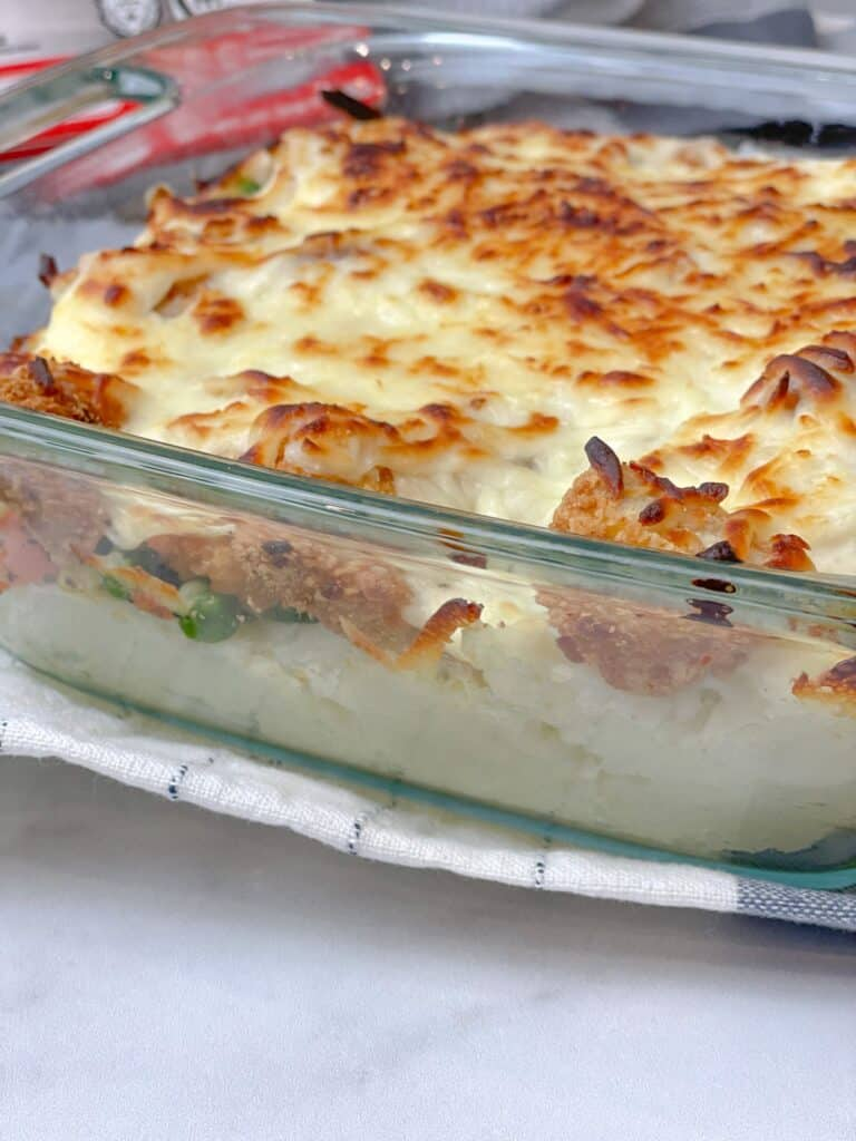 Chicken and potato beshamel baked or broiled in the oven in a tray