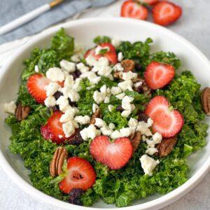 kale salad with pecan cranberries strawberries and Dijon vinaigrette