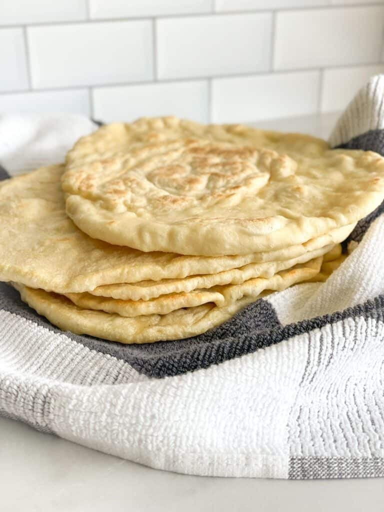 Soft fluffy Flat Bread is cooked in a skillet and can be enjoyed on it's own or dipped in labneh, hummus, or to make your favorite wrap.