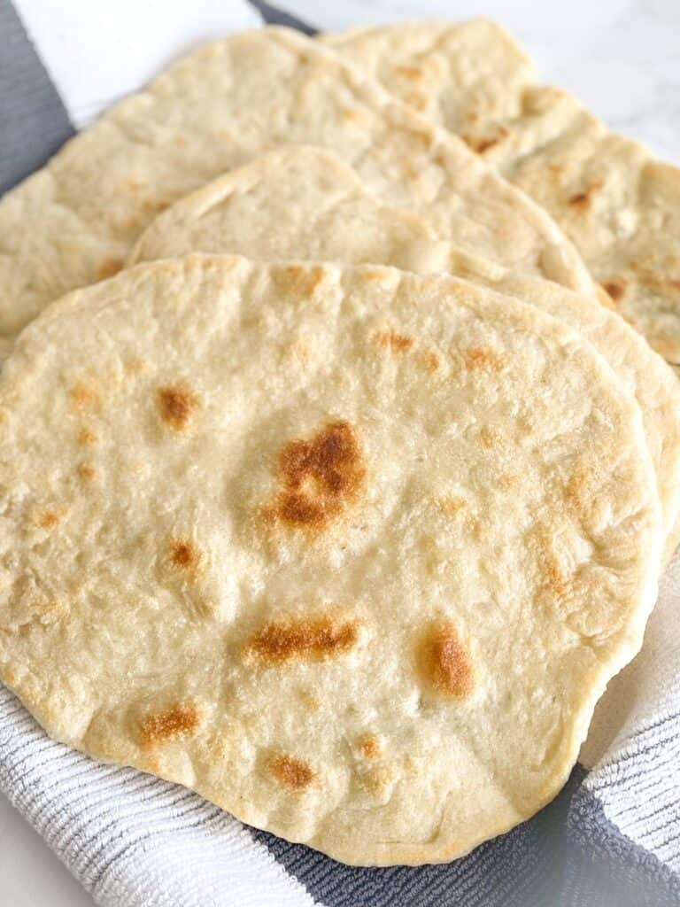 This Simple Skillet Flat Bread is so versatile and requires little effort only a few ingredients from your pantry. The warm, slightly supple dough can be slathered with any topping of your choice.