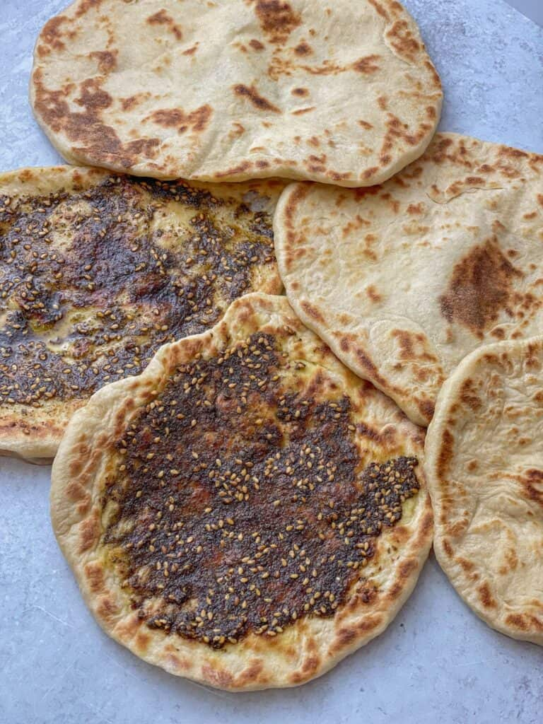 This flatbread is flavored with a Middle Eastern spice mix called Za'atar, which is a mixture of sumac, thyme, oregano, salt, and sesame seed.